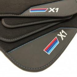 Os tapetes de couro BMW X1...