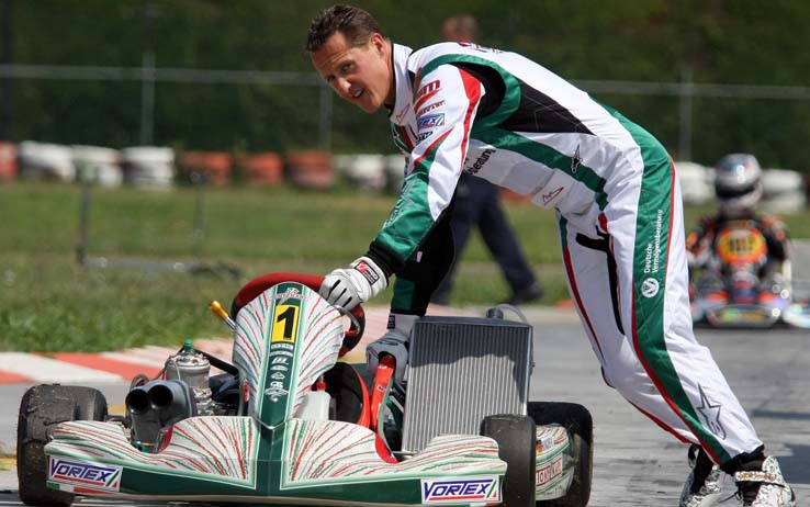 Seven-time Formula One world champion driver Michael Schumacher pushes his cart, at the South Garda Karting track in Lonato, Italy, Thursday, Aug. 6, 2009. Schumacher said Tuesday he is slimming down for his Formula One comeback and the only problem is a little neck pain. Schumacher's first race is expected to be the European Grand Prix in Valencia on Aug. 23. The 40-year-old is returning to his Ferrari team while Felipe Massa recovers from a recent crash. (AP Photo/Felice Calabro')